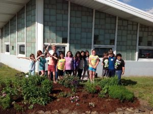 Jr Gardeners join Betty after planting